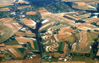 Snow highlighting sinuous countoured farm fields
